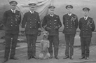 Flag officers and the ship dog on HSM Barham in 1916